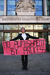 © Licensed to London News Pictures. 19/02/2019. London, UK. Lauri Love stands outside Westminster Magistrates court with a banner reading 'No Punishment by Process' . Mr Love, who previously won an extradition case to face hacking charges in US, recently launched a civil case to recover materials seized by NCA agents at point of arrest over 5 years ago. Today the Judge ruled in favour of the NCA on the basis that the encrypted data on the two computers and drives was not his property. Mr Love sought clarification as to how this assessment had been arrived at, but none was forthcoming. Mr Bird for the NCA requested that the judge consider compelling Mr Love to cover court costs, but this was eventually rejected on technicality and in the spirit of bringing the matter to close. Mr Love commented in court that this request was punitive to the point of deterring normal people from seeking justice. The sitting judge also noted this case was an open judgement, rather than closed and details disclosed during proceedings could subject to future trial. Photo credit: Guilhem Baker/LNP