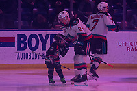 KELOWNA, BC - FEBRUARY 28: The pepsi player collides with forward Kyle Topping #24 of the Kelowna Rockets during the opening of first period against the Everett Silvertips at Prospera Place on February 28, 2020 in Kelowna, Canada. (Photo by Marissa Baecker/Shoot the Breeze)