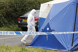 © Licensed to London News Pictures. 16/08/2019. Sulhamstead, UK. The scene near the A4 in Sulhamstead, Berkshire, where a police officer was killed while investigating a suspected burglary. Ten people have been arrested on suspicion of murder including a 13-year-old child. Photo credit: Peter Macdiarmid/LNP