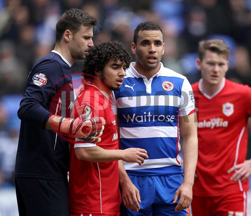 Reading's Hal Robson-Kanu is marked by Cardiff City's Fabio and Cardiff City's David Marshall - Photo mandatory by-line: Robbie Stephenson/JMP - Mobile: 07966 386802 - 04/04/2015 - SPORT - Football - Reading - Madejski Stadium - Reading v Cardiff City - Sky Bet Championship