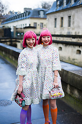 Asian twins Amiaya with pink hair wearing white dress seen outside Valentino during Paris Fashion Week Womenswear Fall/Winter 2018/2019 on March 4, 2018 in Paris, France. (Photo by Nataliya Petrova/NurPhoto/Sipa USA)