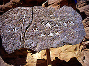 Prehistoric rock carving, at Timna natural and historic park, Israel, The Timna Valley is located in the southwestern Arava, some 30 km. north of the Gulf of Eilat. The traces of ancient civilizations are, too, very interesting to look at in Timna. Copper mining was known there at least from the 18th century B.C. Later Egyptians, who conquered the area, made Timna a very important source of copper. There are many ancient copper mines in the valley, some look like holes in the ground, others are caves hewn in stone; in some places, there are remains of copper-smelting ovens. There is a place where you can see Egyptian rock drawings. At the foot of Solomon's pillars there are remains of an Egyptian temple, and above them are two figures, one of them a pharaoh, engraved in stone by Egyptians.