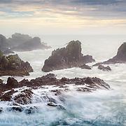 The cliffs and rocky shore beneath Slains Castle
