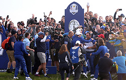 Team Europe's Francesco Molinari (centre right) celebrates with the crowd as Europe are confirmed as Ryder Cup winners during the Singles match on day three of the Ryder Cup at Le Golf National, Saint-Quentin-en-Yvelines, Paris.