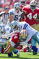 18 September 2011: Runningback (24) Anthony Dixon of the San Francisco 49ers runs the ball and is tackled by (43) Gerald Sensabaugh of the Dallas Cowboys during the first half of the Cowboys 27-24 overtime victory against the 49ers in an NFL football game at Candlestick Park in San Francisco, CA.