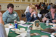 Faculty members enjoy lunch during the Classified Senate Awards in Baker Center Ballroom on Oct. 2, 2014. Photo by Lauren Pond