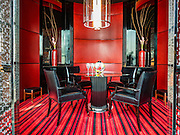 "29 JANUARY 2016 - BANGKOK, THAILAND: The ""crystal room"" one of the private dining rooms at L'atelier de Joel Robuchon, an exclusive French restaurant owned by French chef Joel Robuchon. The restaurant features counter style seating which looks into the kitchen so diners can watch the chefs work.          PHOTO BY JACK KURTZ"