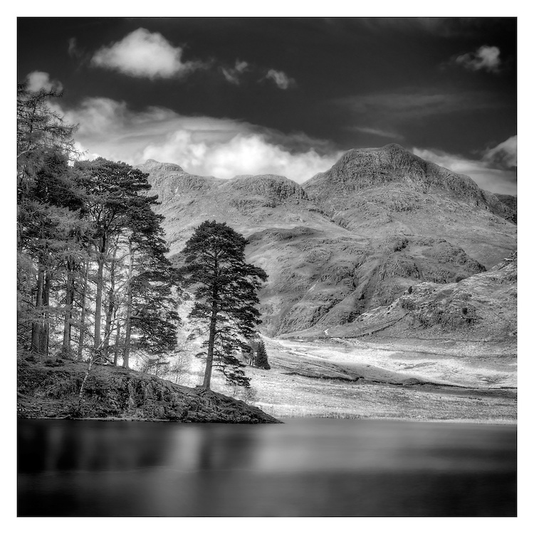Blea Tarn lies in the Lake District of England.<br />