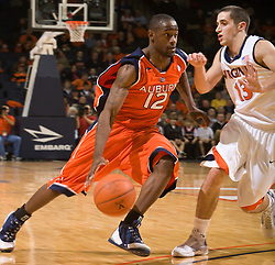 Auburn guard DeWayne Reed (12) dribbles past Virginia guard Sammy Zeglinski (13).  The Auburn Tigers defeated the Virginia Cavaliers 58-56 at the University of Virginia's John Paul Jones Arena  in Charlottesville, VA on December 20, 2008.  (Special to the Daily Progress / Jason O. Watson)
