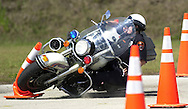 POLK LAKELAND,FL.- POMOTOR - Lakeland Police Officer Elisa Martin takes a spill as she runs the obstacle course at Lakeland Police Training Range. Martin was taking the motorcycle certification course to become a motor officer.  Elisa Martin survives two weeks of difficult training to become Lakeland's first female motorcycle cop.   (staff/scott iskowitz)
