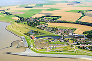 Nederland, Groningen, Gemeente Delfzijl, 05-08-2014; Termunterzijl dorp aan de Eems. Waterstaatkundige geschiedenis in beeld met binnenhaven, sluizen en gemalen.<br /> Village at the river Ems with marina. Hydraulic history in pictures, inner harbor, locks and pumping stations of different date.<br /> luchtfoto (toeslag op standard tarieven);<br /> aerial photo (additional fee required);<br /> copyright foto/photo Siebe Swart