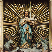 A statue on the altar at the the Iglesia de Santa Ines (Church of Saint Agnes) in the historic Centro Historico district of downtown Mexico City, Mexico.