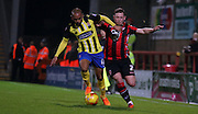 Ashley Chambers challenges Shaun Beeley during the Sky Bet League 2 match between Morecambe and Dagenham and Redbridge at the Globe Arena, Morecambe, England on 1 December 2015. Photo by Pete Burns.