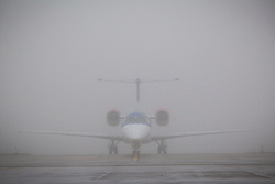 © Licensed to London News Pictures . 09/01/2013 . Manchester , UK . A plane sits on the ground in thick fog . Thick fog is causing flight delays and cancellations in the North of England today (9th January 2013) . Photo credit : Joel Goodman/LNP