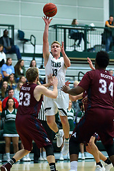 17 November 2017:  Brady Rose shoots over Rob Holmes during an College men's division 3 CCIW basketball game between the Alma Scots and the Illinois Wesleyan Titans in Shirk Center, Bloomington IL