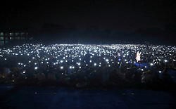 October 2, 2018 - Mumbai, Maharashtra, India - Students hold up solar lamps as they break the world record for for lighting the most number of solar LED lamps simultaneously in Mumbai on September 2, 2018.  .Over 5,000 students from 120 schools in the Mumbai Metropolitan Region entered Guinness World Records Tuesday for lighting the most number of solar LED lamps simultaneously. The previous record was achieved in 2016 when 1,590 participants were successful at achieving the record. (Credit Image: © Prash Way/NurPhoto/ZUMA Press)