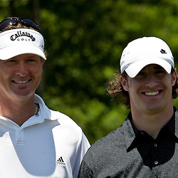 2009 April 22: PGA Tour Pro, Tim Petrovic (L) teamed with Drew Brees quarterback of the NFL's New Orleans Saints (R) during the PGA Tour, Zurich Classic of New Orleans Classic Pro-Am played at TPC Louisiana in Avondale, Louisiana.