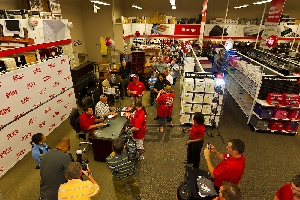 HOUSTON, TX - MAR 28, 2012:  NASCAR Champion, Tony Stewart (14), signs autographs at the Office Depot Store #663 in Houston, TX.