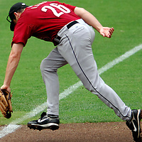 18 July 2007:  Houston Astros third baseman Mike Lamb (26) cannot come up with a 2-run RBI double down the line in the 1st inning hit by Washington Nationals right fielder Austin Kearns that scored Ryan Church and Dmitri Young.  The Nationals defeated the Astros 7-6 at RFK Stadium in Washington, D.C.  ****For Editorial Use Only****