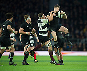 Twickenham, Surrey. England.  All Black. Beauden BARRETT , shield the ball from the challenge od Baa Baa's, Jerome KAINO, during the Killik Cup, Barbarians vs New Zealand. Twickenham. UK<br /> <br /> Saturday  04.11.17<br /> <br /> [Mandatory Credit Peter SPURRIER/Intersport Images]