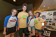 Students that are part of the WUD Film Committee pose for a picture in front of their table at the Marquee in Union South at Sunburst Festival in 2014.