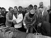 Cork / Dublin Gas Pipeline.28.04.1982.04.28.1982.28th April 1982.1982...At Brownbarn,Kingswood,Dublin the Minister for Industry and Energy, Mr Albert Reynolds T.D. performed the ceremonial first weld to officially start the project..The 24cm diameter pipe is cleaned prior to welding. The minister takes over and cleans the pipe himself.
