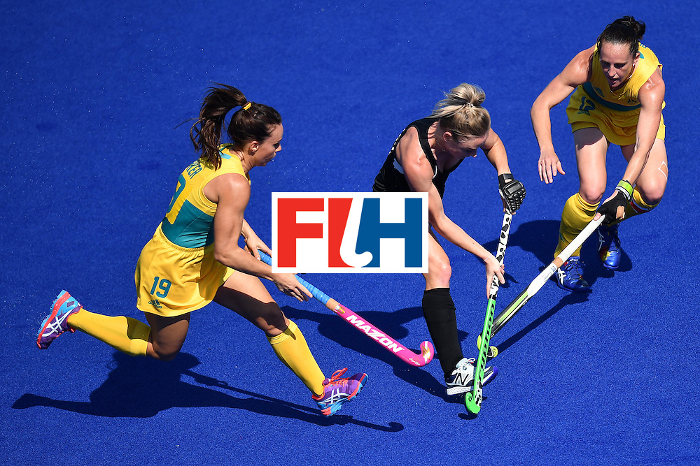 Australia's Georgie Parker and Australia's Madonna Blyth (R) vies with New Zealand's Anita McLaren (C) during the the women's quarterfinal field hockey New Zealand vs Australia match of the Rio 2016 Olympics Games at the Olympic Hockey Centre in Rio de Janeiro on August 15, 2016. / AFP / MANAN VATSYAYANA        (Photo credit should read MANAN VATSYAYANA/AFP/Getty Images)