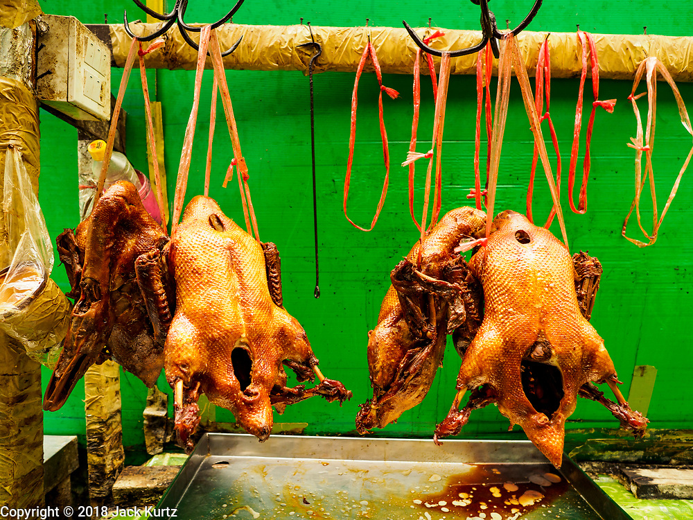 31 JULY 2018 - BANGKOK, THAILAND: Roast chickens for sale in Bangkok's Chinatown district. It is one of the largest Chinatowns in the world. It was established in 1781 when Siamese King Rama I gave the Chinese community in Bangkok land outside of Bangkok's city walls so he could build his palace (what is now known as the Grand Palace). Chinatown is now the heart of the Thai-Chinese community. About 14% of Thais have Chinese ancestry.    PHOTO BY JACK KURTZ