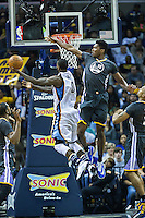MEMPHIS, TN - DECEMBER 10:  JaMychal Green #0 of the Memphis Grizzlies goes up for a shot against Damian Jones #15 of the Golden State Warriors at the FedExForum on December 10, 2016 in Memphis, Tennessee.  The Grizzlies defeated the Warriors 110-89.  NOTE TO USER: User expressly acknowledges and agrees that, by downloading and or using this photograph, User is consenting to the terms and conditions of the Getty Images License Agreement.  (Photo by Wesley Hitt/Getty Images) *** Local Caption *** JaMychal Green; Damian Jones