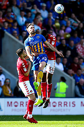 Alex Rodman of Shrewsbury Town beats Anfernee Dijksteel of Charlton Athletic to a header - Mandatory by-line: Robbie Stephenson/JMP - 13/05/2018 - FOOTBALL - Montgomery Waters Meadow - Shrewsbury, England - Shrewsbury Town v Charlton Athletic - Sky Bet League One Play-Off Semi Final