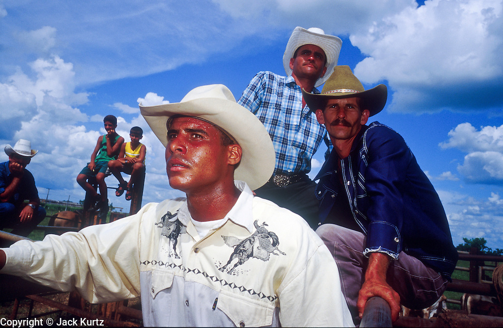 28 JULY 2002 - JOVELLANOS, MATANZAS, CUBA: Cowboys watch an amateur rodeo in the town of Jovellanos, province of Matanzas, Cuba, July 28, 2002..PHOTO BY JACK KURTZ