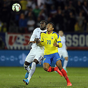 Jozy Altidore, (left), USA, challenges Luis Canga, Ecuador,   during the USA Vs Ecuador International match at Rentschler Field, Hartford, Connecticut. USA. 10th October 2014. Photo Tim Clayton