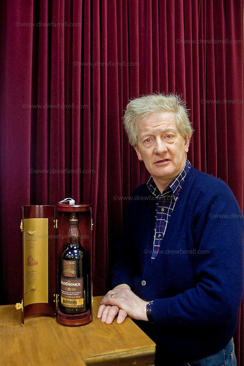 Picture shows : John Adamson pictured with pre auction choice (Lot 13 - Glendronach 33 year old)..Fine & Rare Whisky & Port Auction. Spring 2009. McTears Auctioneers, Glasgow. .Wednesday 25th February 2009..Re Ingvild Paulsen Feature..Picture Drew Farrell..Tel : 07721-735041.....