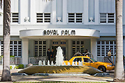 Art deco architecture at The Royal Palm Hotel and taxi cab in Collins Avenue, Miami South Beach, Florida USA