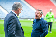 Inverness manager, John Robertson shares a joke with former team mate and now Heart of Midlothian manager Craig Levein before the William Hill Scottish Cup semi-final match between Heart of Midlothian and Inverness CT at Hampden Park, Glasgow, United Kingdom on 13 April 2019.
