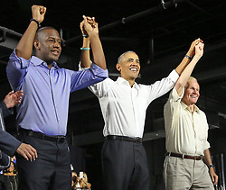 From left, Andrew Gillum, Democratic nominee for governor of Florida, former President Barack Obama and U.S. Senator Bill Nelson join hands during a campaign rally at Ice Palace Films Studios in Miami, FL, USA, on Friday, November 2, 2018. Photo by Al Diaz/Miami Herald/TNS/ABACAPRESS.COM
