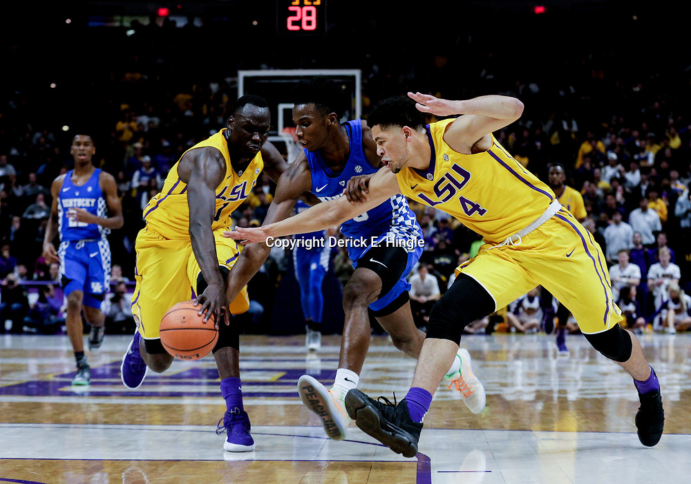 Jan 3, 2018; Baton Rouge, LA, USA; LSU Tigers guard Skylar Mays (4) and forward Duop Reath (1) knock the ball from Kentucky Wildcats guard Hamidou Diallo (3) during the first half at the Pete Maravich Assembly Center. Mandatory Credit: Derick E. Hingle-USA TODAY Sports
