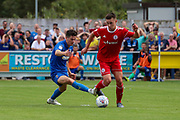 AFC Wimbledon midfielder Callum Reilly (33) battles for possession with Accrington Stanley midfielder Jordan Clark (7) during the EFL Sky Bet League 1 match between AFC Wimbledon and Accrington Stanley at the Cherry Red Records Stadium, Kingston, England on 17 August 2019.