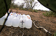 Water provided as humanitarian aid by Rev. Mike Wilson sit along trails used by undocumented migrants crossing into the United States from Mexico on the Tohono O'odham Nation in Arizona. The area, which is south of Little Tucson, has the highest death rate of undocumented migrants along the 2,000 mile stretch of border.