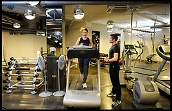 Celebrity Personal Trainer Matt Roberts training a lady on a running machine in his Gym in West London, Tuesday August 9, 2011. Matt trains the Prime Minister David Cameron amongst other celebrities.  Photo By Andrew Parsons