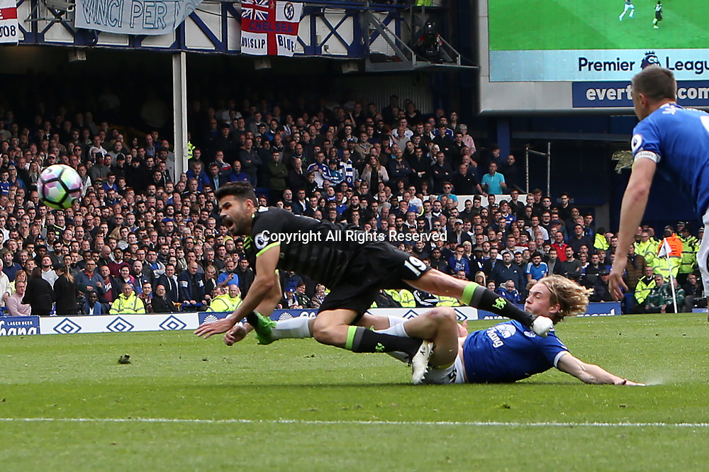 April 30th 2017, Goodison Park, Liverpool, England; EPL Premier league football, Everton versus Chelsea;  Diego Costa of Chelsea is slide tackled on the edge of the penalty area by Tom Davies of Everton