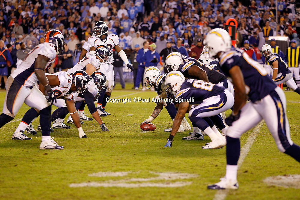 San Diego Chargers center Nick Hardwick (61) gets set to snap the ball at the line of scrimmage during the NFL week 11 football game against the Denver Broncos on Monday, November 22, 2010 in San Diego, California. The Chargers won the game 35-14. (©Paul Anthony Spinelli)