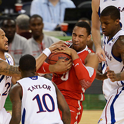 Mar 31, 2012; New Orleans, LA, USA; Kansas Jayhawks guard Travis Releford (24) attempts to steal the ball from Ohio State Buckeyes forward Jared Sullinger (0) as guard Tyshawn Taylor (10) and forward Thomas Robinson (far right) defend during the second half in the semifinals of the 2012 NCAA men's basketball Final Four at the Mercedes-Benz Superdome. Mandatory Credit: Derick E. Hingle-US PRESSWIRE