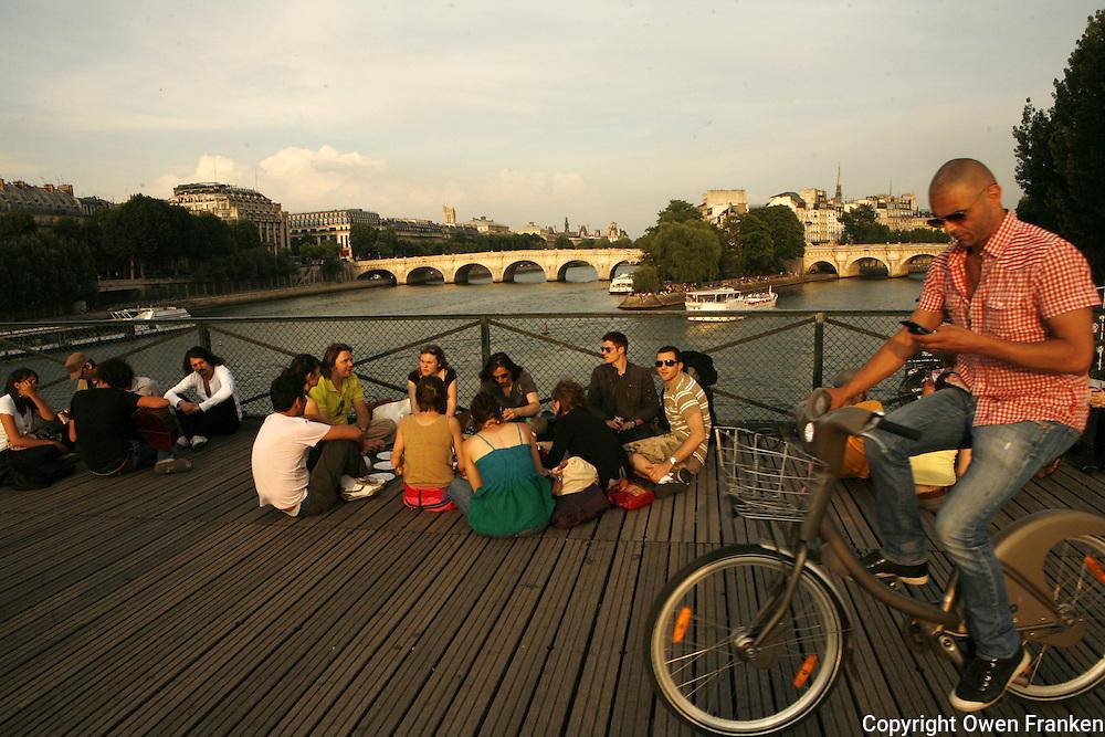 on the Pont des Arts, a foot bridge in Paris - photograph by Owen Franken