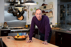 © Licensed to London News Pictures. 10/01/2014. Jon Thompson who had his flat trashed when he rented it out through Airbnb, and later discovered that he wasn't insured. Pictured here in the last the was damaged.  Photo credit: Ben Cawthra/LNP
