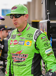 April 6, 2018 - Fort Worth, TX, U.S. - FORT WORTH, TX - APRIL 06: Monster Energy NASCAR Cup Series driver Kyle Busch (18) looks over his car during the Monster Energy NASCAR Cup Series practice on April 6, 2018 at the Texas Motor Speedway in Fort Worth, Texas. (Photo by Matthew Pearce/Icon Sportswire) (Credit Image: © Matthew Pearce/Icon SMI via ZUMA Press)
