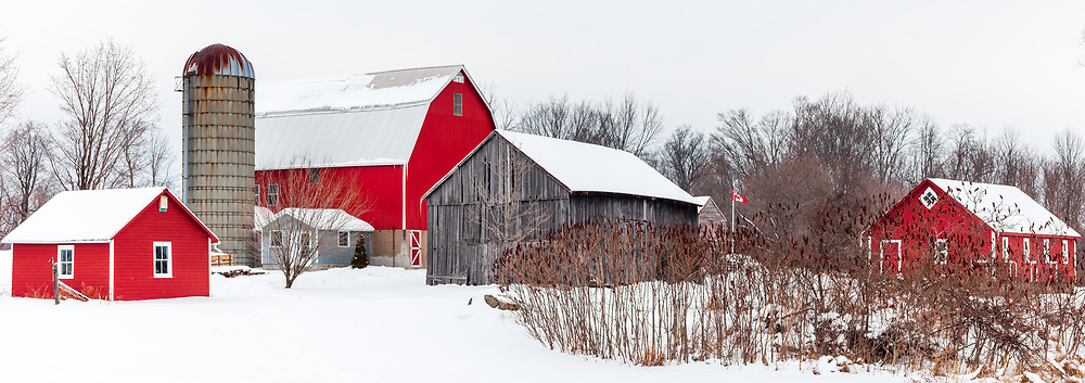 https://Duncan.co/farm-with-red-buildings-in-winter