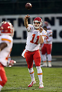 Kansas City Chiefs quarterback Alex Smith (11) throws a pass while warming up before the NFL week 12 regular season football game against the Oakland Raiders on Thursday, Nov. 20, 2014 in Oakland, Calif. The Raiders won their first game of the season 24-20. ©Paul Anthony Spinelli