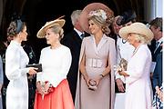"""Koning Willem Alexander wordt door Hare Majesteit Koningin Elizabeth II geïnstalleerd in de 'Most Noble Order of the Garter'. Tijdens een jaarlijkse ceremonie in St. Georgekapel, Windsor Castle, wordt hij geïnstalleerd als 'Supernumerary Knight of the Garter'.<br /> <br /> King Willem Alexander is installed by Her Majesty Queen Elizabeth II in the """"Most Noble Order of the Garter"""". During an annual ceremony in St. George's Chapel, Windsor Castle, he is installed as """"Supernumerary Knight of the Garter"""".<br /> <br /> Op de foto / On the photo: Queen Letizia , Queen Maxima ,Camilla Parker Bowles"""
