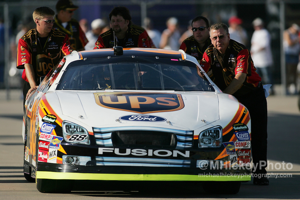 Dale Jarrett's crew pushes his car to inspection before qualifications for the Allstate 400 at the Brickyard Aug 5, 2006.